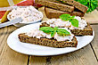 Toast Two Slices Of Rye Bread With Cream Of Salmon And Mayonnaise, Basil, Knife, Napkin, Parsley On A Wooden Boards Background