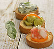 Toasted Bread Slices With Spinach Dip,Avocado,Cheese And Tomatoes stock photography