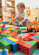 Toddler Playing With Logo Blocks On Floor stock image