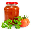 Tomato Ketchup In A Glass Jar, One Tomato, A Sprig Of Parsley stock image