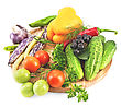 Tomatoes, Cucumbers, Sweet And Hot Peppers, Pea Pods, Three Pods Of Beans, Garlic, Parsley, Dill, Tarragon And Brush Aronia On A Wooden Circular Board stock image