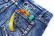 Tools In Blue Jeans Pocket On White Background. stock photo