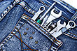 Tools In Blue Jeans Pocket On White Background. stock photography