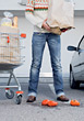 Torn Shopping Bag Dropping Tomatoes stock image