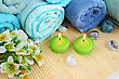 Towels, candles, stones and flowers on bamboo mat. stock image