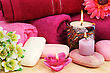 Towels, Soaps, Flowers And Candles On Mat Background. stock photography