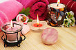 Towels, Soaps, Flowers And Candles On Mat Background. stock image