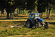 User Tractor Mowing Pasture For Silage, West Coast, South Island, New Zealand stock photography