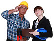 Tradesman And Engineer Looking At The Ceiling stock photo