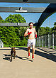 Athletic Training Before The Fight. Boxer And Dog Running Outdoors. stock photo