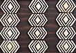 Tribal wood art simple primitive ivory & brown trivet stock image