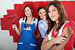 Trio Of Handygirls Painting Room Red stock photography