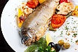 Rainbow Trout Fish Baked With Pepper, String Beans, Tomato And Cauliflower stock photo