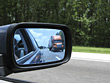 Truck in Rearview Mirror stock photo