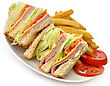 Turkey Or Ham Club Sandwich And French Fries stock photography