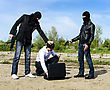Two Bandits Kidnapped A Businessman With A Suitcase stock photo