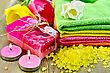 Two Bars Of Homemade Soap, Towels, Bath Salts, Two Candles And Tulips On A Background Of The Old Wooden Boards stock photography