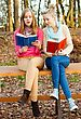 Two Beautiful Young Women Reading Their Books stock image
