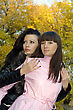 Two Beauty Young Women Outdoors In The Autumn stock photo