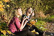 Two Beauty Young Women Starts Up Soap Bubble In Park stock photo