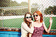 Two Best Friends Young Girls Staying Together At The School Court, Wearing Sunglasses. Sunny Day stock photography