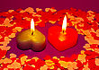 Two Burning Heart Shaped Candles Over Purple Background stock photo