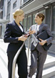 Two Business Women Having Discussion Outside Office Building stock photo