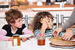 Two Children At Kitchen Table Having Breakfast stock image