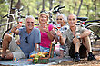 Two Couple Having Picnic Whilst On Bike Ride stock photography