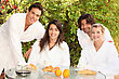Two Couples Sharing Breakfast stock photo