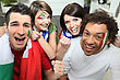 Two Couples Supporting Italian Football stock photo