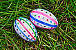Two Easter Eggs, Decorated With Multicolored Braid And Sparkles As Asterisks On Green Grass Top stock image