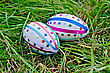 Two Easter Eggs, Decorated With Multicolored Braid And Sparkles As Asterisks On The Green Grass stock photo