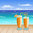 Two Glasses Of Orange Drink On The Background Of A Tropical Beach