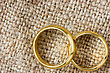 Two Golden Wedding Rings On The Burlap stock image