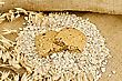 Two Halves Of Biscuits Made From Oats And Berries On A Pile Of Oatmeal, Oat Stalks On Burlap And Wooden Board