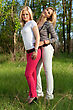 Two Happy Attractive Blonde In Pink And White Jeans Outdoors