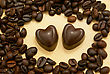 Two Heart Shaped Chocolate Candies And Coffee Beans On Grungy Paper