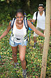 Two Hikers With Backpacks In The Forest stock photo