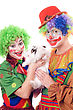 Two Joyful Clown With A White Rabbit. stock image