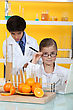 Two Kids In Science Laboratory stock photography