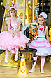 Magnificent Two Little Elegant Girls Posing On The Carousel stock photo