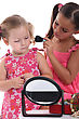 Tied Two Little Girls Playing With Make-up stock image