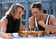 Two Men Playing Chess stock photography