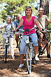 Two Middle-aged Couples Riding Bicycles stock image