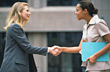 Two Multi-Ethnic Business Women Shaking Hands stock photo