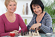 Two Old Friends Playing Chess stock photo