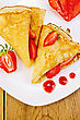 Two Pancakes With Strawberries And Jam On A White Plate On A Wooden Board stock photography