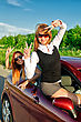 Two Pretty Happy Girls In The Car. Concept Of Carefree Roadtrip stock photography