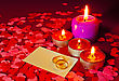 Two Rings And A Card With Marriage Proposal With Four Candles On The Red Background stock photography